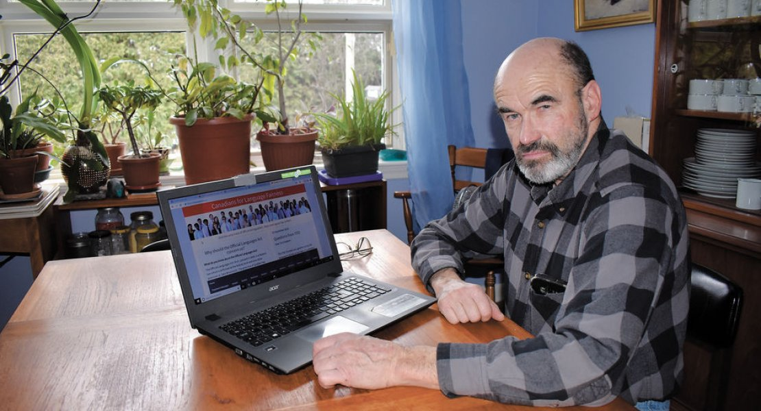 Jean-Serge Brisson on Laptop